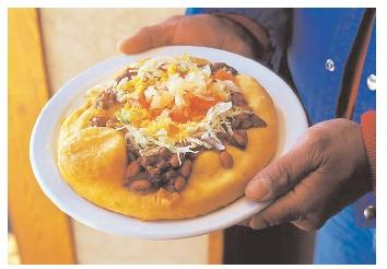 The frybread taco is a relatively recent addition to Native American fare. It requires white wheat flour, which came to the New World with Europeans. [Photograph by Catherine Karnow. Corbis. Reproduced by permission.]