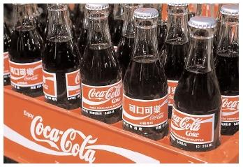 John S. Pemberton's 1886 Coca-Cola recipe contained a highly addictive stimulant extracted from coca leaves. That recipe was replaced in 1905 with one more similar to the modern beverage, which is distributed in 200 countries worldwide. [© Sergio Dorantes/Corbis. Reproduced by permission.]