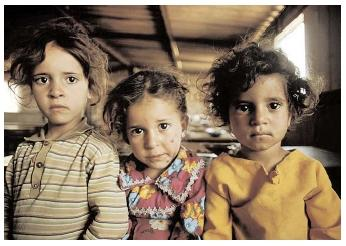These girls are among more than four million Palestinian refugees in Gaza Strip and the West Bank. A recent report from the Refugee Nutrition Information System found Palestinian refugees to be satisfactorily coping with the nutritional impacts of the latest Intifada. [Corbis. Reproduced by permission.]