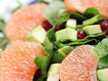 Avocado Fruit Salad Over Spinach recipe